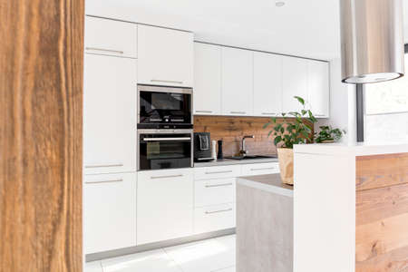 kitchen island: Modern white kitchen with island and white furniture Stock Photo