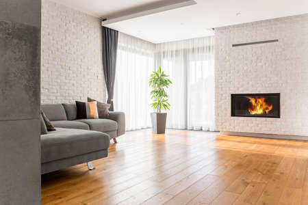 wall design: Living room with wood flooring, fireplace and sofa