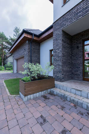 Modern front house entrance with paving stone doorway Stock fotó