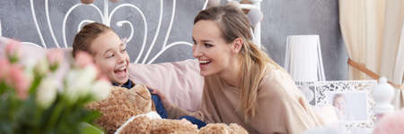 motherly: Adolescent daughter and her young mum having fun together