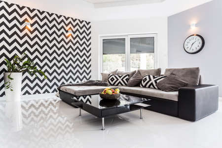 ascetic: Posh living room with white tiled floor and black lounge set
