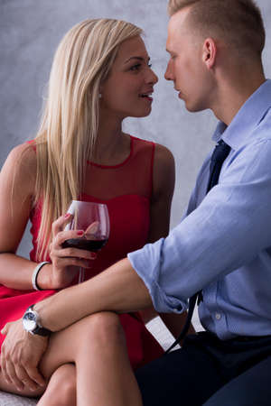 Young beautiful couple flirting with each other during date Stock Photo