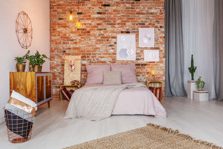 Stylish pink and copper decor of cozy bedroom