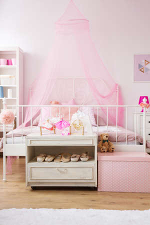 Bedroom of tiny ballet dancer with cozy bed Stock Photo
