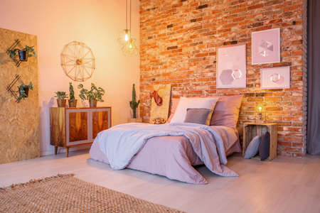 Cozy bedroom with wooden and brick decorations