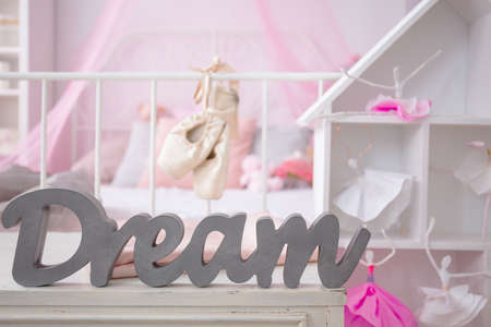 Pink room of girls dreams with stylish dollhouse