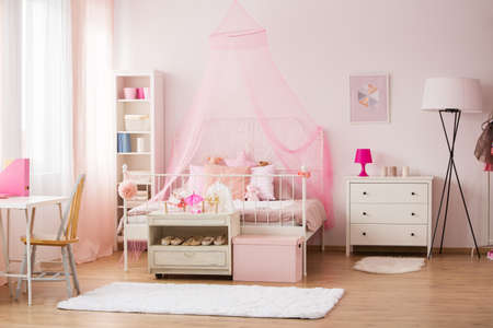 Room for young girl with pink decorations and bed