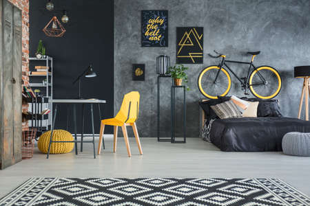 Modern studio flat of a man with yellow decors Reklamní fotografie - 76957124