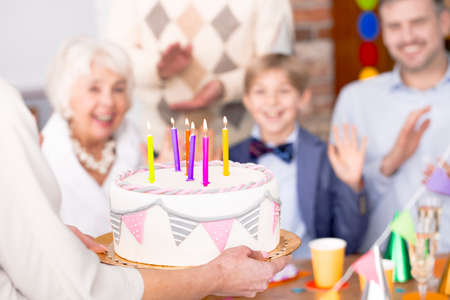 Beautiful birthday cake with decoration and colorful candles, close up