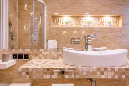 Ancient style bathroom with marble walls and top Stock Photo