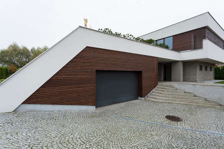 Exterior of a modern house with functional garage