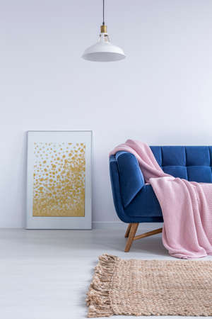 Cozy space for relax with blue sofa and pink blanket Stock Photo
