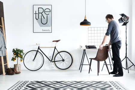 New, white room with desk, chair, bike, pattern carpet