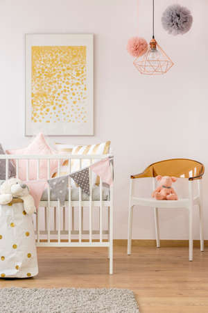 Polka Dot Wall Decor In Functional Interior Of White Baby Nursery