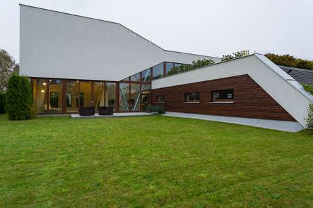 Spacious garden of modern house with cozy terrace
