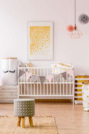 Newborn room in scandinavian style with white cot and stool Stock Photo