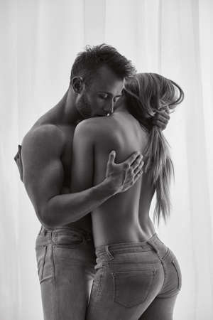 Couple in erotic situation with jeans only