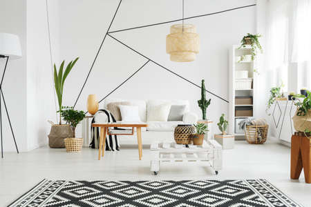 Contemporary design of cozy simple lounge with plants Stock Photo