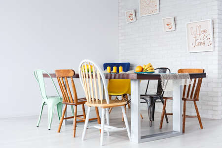 Up-to-date simple design of dining room with wooden table and chairs Stock Photo
