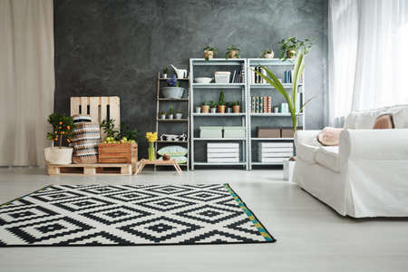 Black and white spacious living room with natural botanic design 版權商用圖片