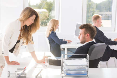 fondness: Young couple flirting at the office during work