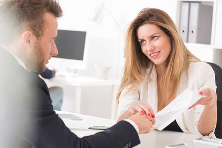 fondness: Attractive boss seducing her employee in suit at the office Stock Photo