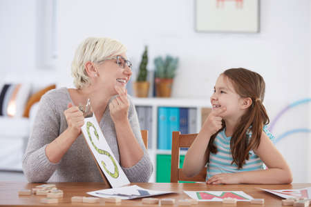 Therapy session with young girl learning the alphabet Stock Photo