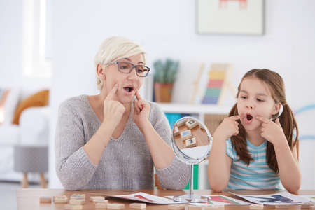 Proper articulation therapy for girl learning to speak Stock Photo