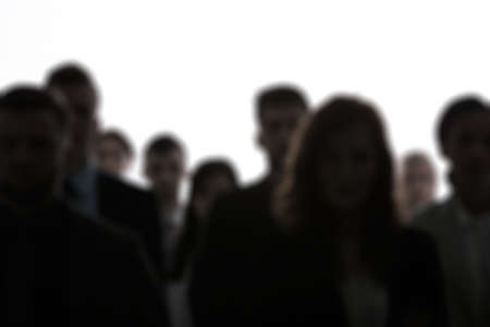 Blurred people silhouettes standing in a crowd