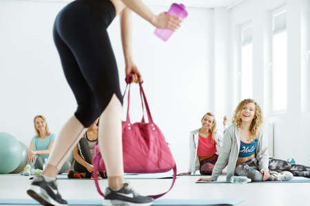 Fitness instructor coming on classes with her group Stock Photo