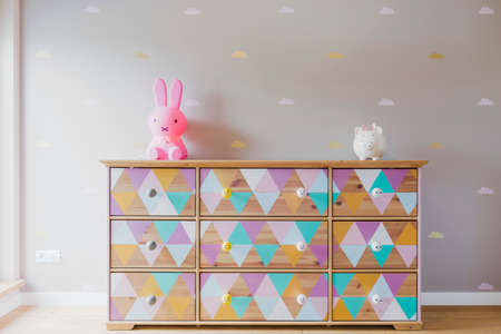 chest of drawers: DIY colorful patterned commode with toys in pastel girl room