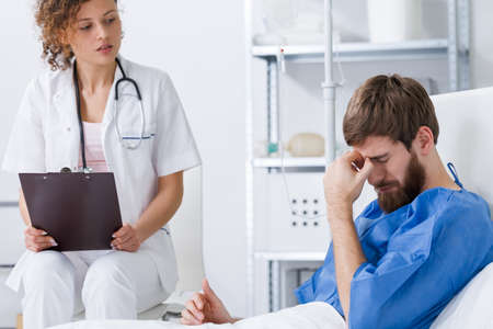Psychiatrist supporting depressed patient having stress breakdown