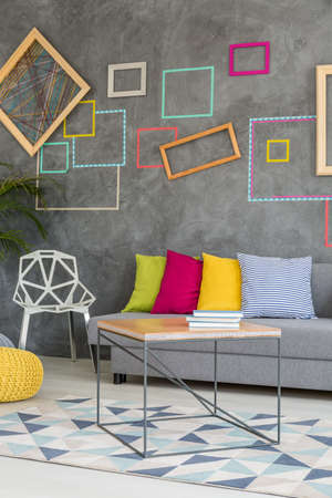 living room design: Grey living room with modern colorful accents