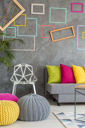living room design: Living room with modern poufs, sofa and crystal chair