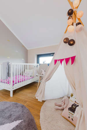 Creative cozy child rrom with teepee, toys and baby cot