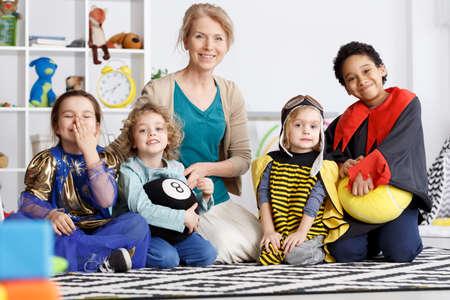 Preschool kids from kindergarten group dressed in colorful costumes