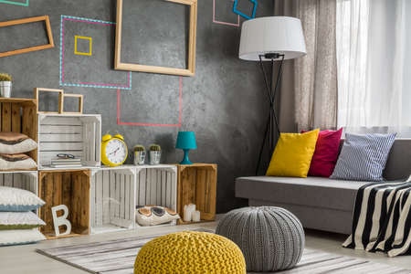 Beau Modern Style Living Room With Diy Regale, Sofa And Poufs Stock Photo    78530185