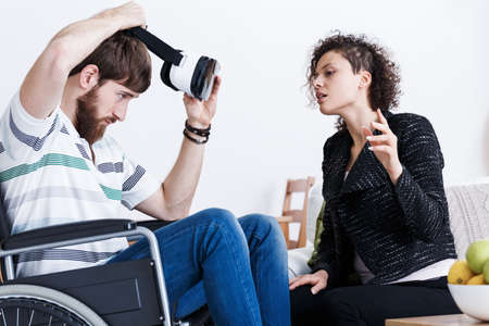stress testing: Young man in wheelchair testing virtual reality technology Stock Photo