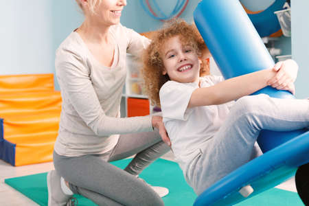 Child swinging on pediatric swing during sensory integration session