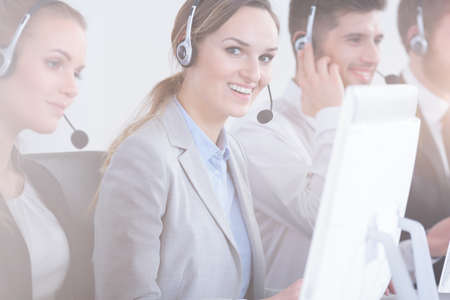 salespeople: Positive call center woman accompanied by her team