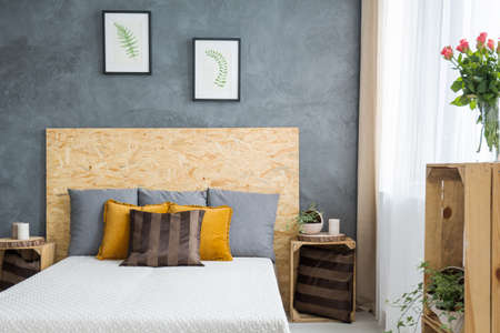 Wooden decoration on grey bedroom with colorful additions Stock Photo