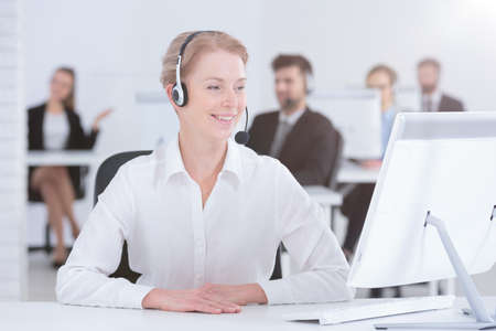 customer support: Happy adult woman working in call center Stock Photo