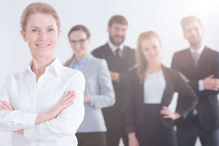 salespeople: Professional team leader of young customer service team Stock Photo