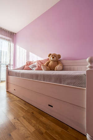 hotel bedroom: Lavender bedroom for girl with bed and teddy bear