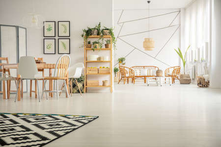 open floor plan: White, open plan home interior with table, chair, pattern carpet