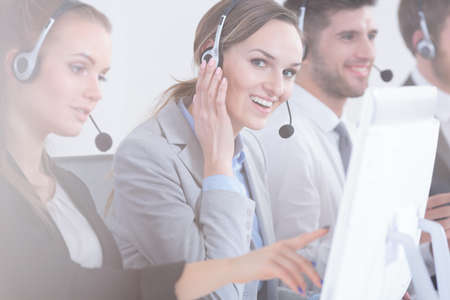 salespeople: Happy customer support operators in modern office Stock Photo