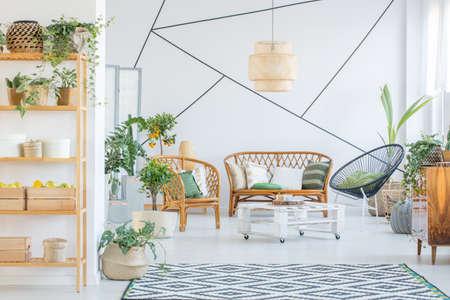 White, botanic living room with rattan furniture set