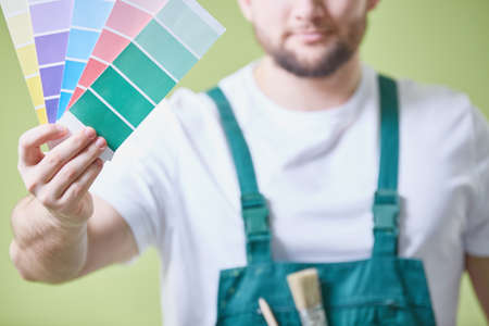 Painter is choosing the colour of the paint