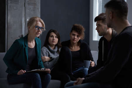 Young people in rehab center on group psychotherapy Stock Photo