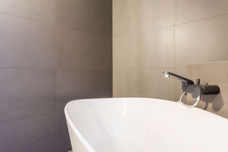 apartment: White bath in modern grey bathroom interior Stock Photo